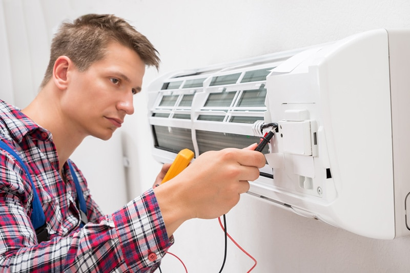 man looking at ductless unit